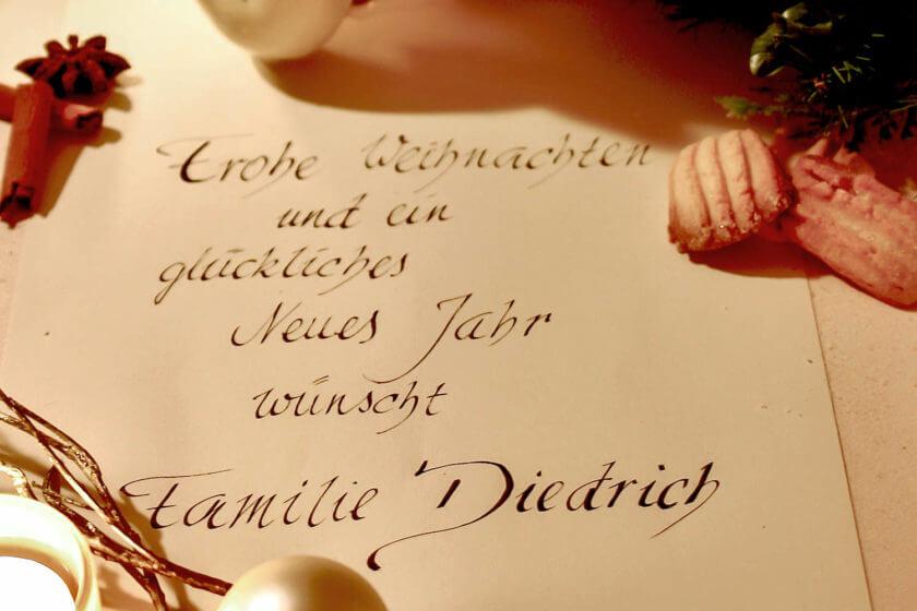 Ein handgeschriebener Brief, auf dem Familie Diedrich frohe Weihnachten wünscht